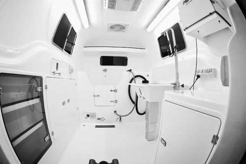 inside fibreglass mobile dog grooming trailer hydrobath